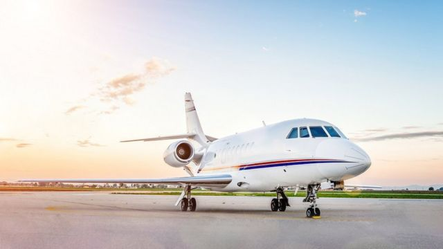 A luxury private jet parked at an airport