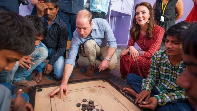 The Duke and Duchess of Cambridge with street children