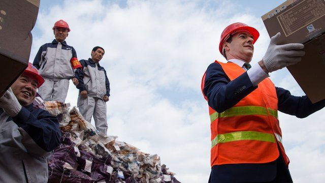 Chancellor of the Exchequer George Osborne visits an industrial area in the city of Urumqi in north west China