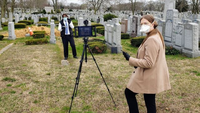 Tribucast staff preparing to live stream a burial