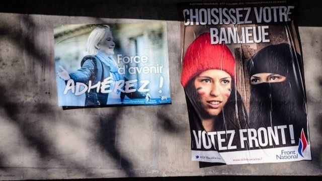 "An election campaign poster for French far-right Front National (FN) party reads ""Choose Your Suburb - Vote Front"" and features a Muslim woman, wearing an islamic veil and with the French national colours painted on her face."