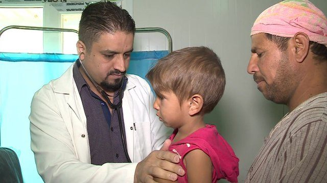 A doctor examining a child