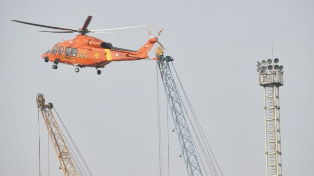 A Search and rescue helicopter flies during an operation for the ill-fated Lion Air flight