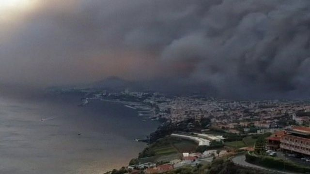 Billowing black smoke over Madeira coastline