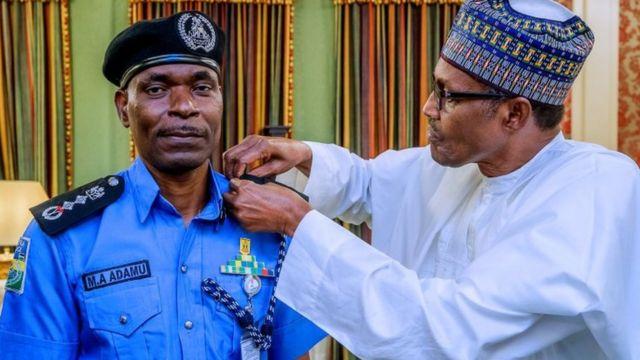 Mohammed Adamu wit Muhammadu Buhari