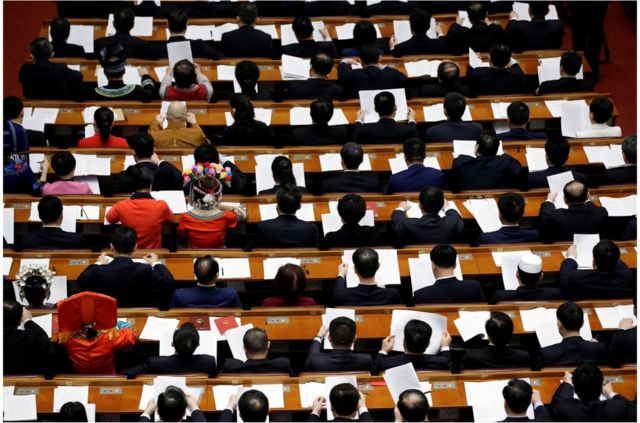 """Delegates attend the fourth plenary session of the National People""""s Congress (NPC) at the Great Hall of the People in Beijing, China March 13, 2018. REUTERS/Jason Lee"""