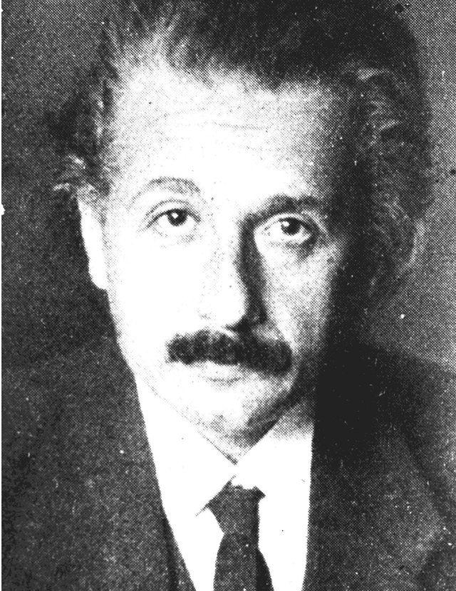 grainy black and white photograph of Albert Einstein