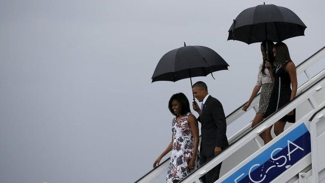 US President Barack Obama, his wife first lady Michelle, and their daughters Malia and Sasha, exit Air Force One as they arrive at Havana's international airport for a three-day trip, in Havana, Cuba on 20 March, 2016