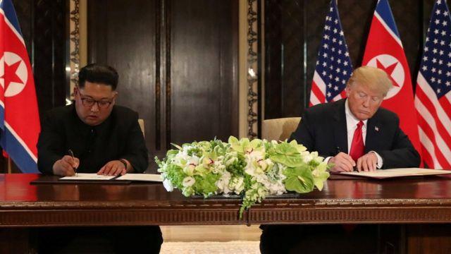 Kim and Trump sign