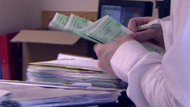 Doctor writing prescriptions
