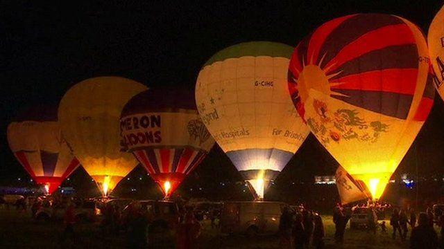 Balloons lit up at the Bristol International Balloon Fiesta