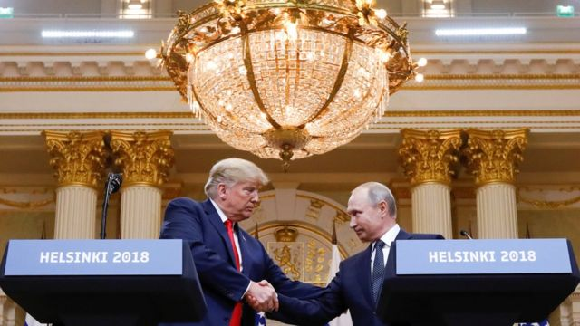 "U.S. President Donald Trump and Russia""s President Vladimir Putin shake hands during a joint news conference after their meeting in Helsinki, Finland, July 16, 2018"