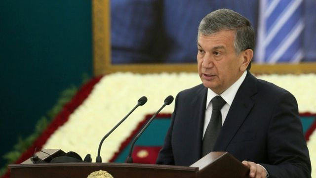 Uzbek Prime Minister Shavkat Mirziyoyev delivers a speech near a portrait of late President Islam Karimov during a mourning ceremony in Samarkand, Uzbekistan, September 3, 2016.