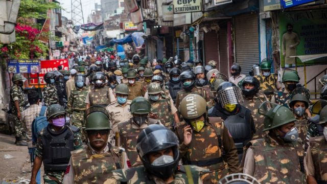 Indian policemen patrol amid a nationwide lockdown over the highly contagious novel coronavirus
