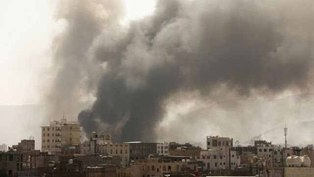 Smoke billows from the site of Saudi-led air strikes in Sanaa, Yemen, on 7 March 2021