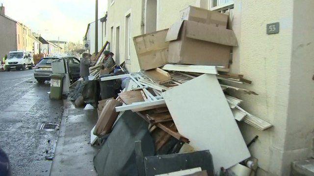 Aftermath of flooding shows damaged furniture