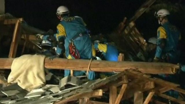 Rescuers search collapsed buildings in Kumamoto