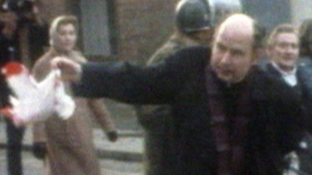Fr Edward Daly waves a bloodied handkerchief in Londonderry on 30 January 1972