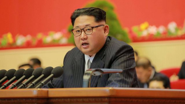 Kim Jong-un speaking from a lecturn