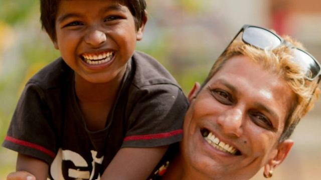 Mark Rego with one of the children from the Jeevarathni Foundation - a home for destitute children