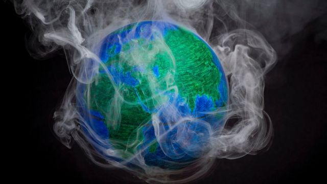 Model of the Earth with smoke coming off it