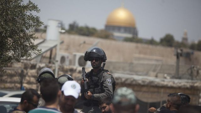 An Israeli border police officer is seen during Friday prayers