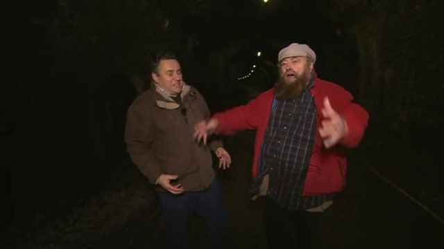 Actor Brian Blessed testing a tunnel's acoustics