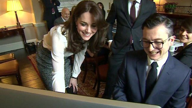 The duchess talks to editor of the Huffington Post in Kensington Palace