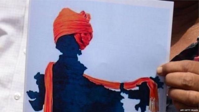 காஷ்மீரில் காவி துண்டு கட்டப்பட்டதாக சித்தரிப்பு படம்