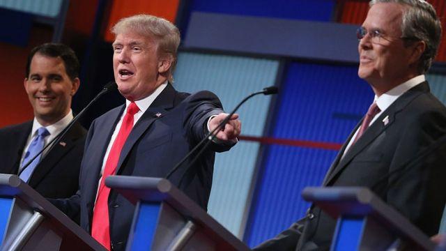 Masu son yi wa Republican takara (L-R) Gwamnan Wisconsin Scott Walker, Donald Trump da kuma Jeb Bush sun yi muhawararsu ta farkowacce gidan talabijin na FOX News and Facebook suka hada a dandalin Quicken Loans a Cleveland, Ohio.