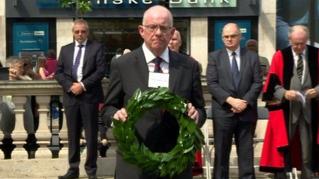 Republic of Ireland Minister, Charlie Flanagan laying a wreath at Belfast City Hall