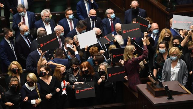 "Female opposition deputies block the rostrum of the Sejm as the ""For Life"" programs were announced in the Lower House in Warsaw"