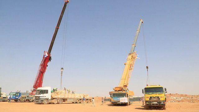 Cranes delivering aid to the Syria-Jordan border