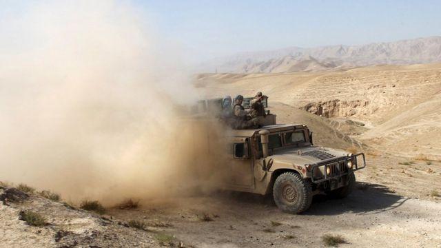 An Afghan security vehicle advances towards the city of Kunduz