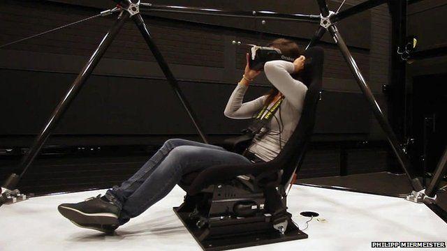 A person in a virtual reality simulator