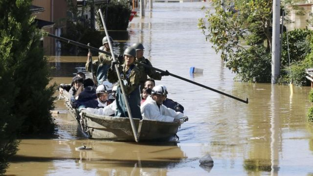 Soldiers use boats to rescue residents hit by floods in Japan