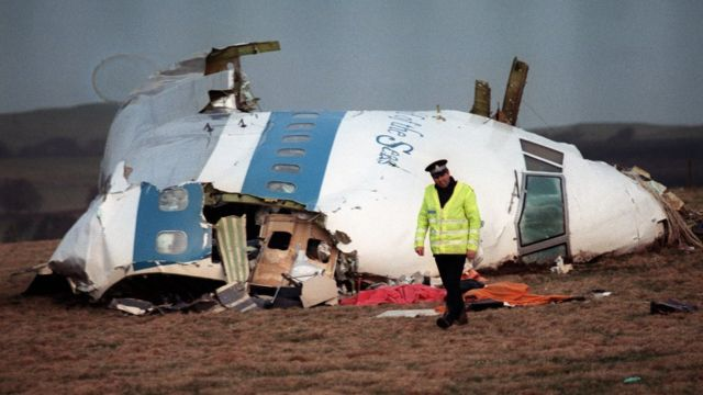 Pieces of the Pan Am plane on the ground.