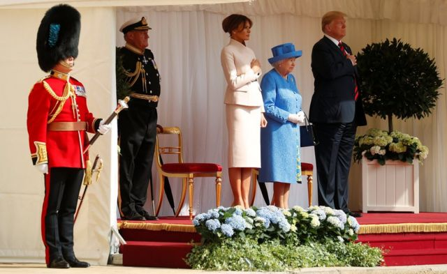 US President Donald Trump and the First Lady Melania Trump are met by Britain's Queen Elizabeth