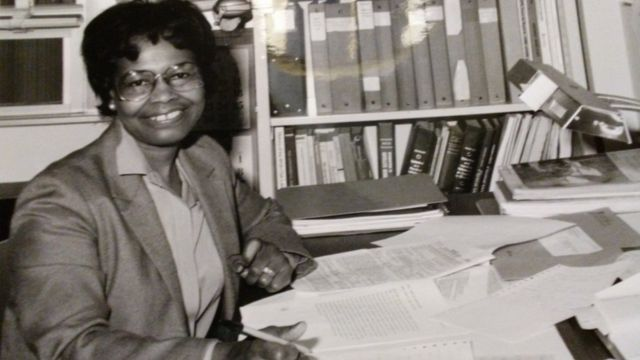 Gladys West at her office desk