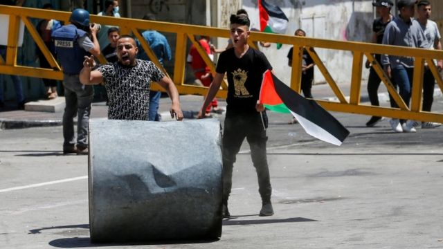 Palestinians demonstrating in the occupied West Bank