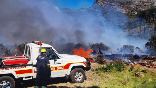 Fire rages on foothills of Cape Town's Table Mountain