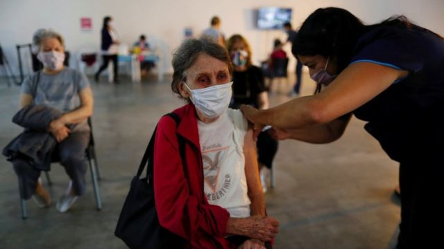 A woman receives a dose of Sputnik V (Gam-COVID-Vac) vaccine against coronavirus disease (COVID-19) at Tecnopolis Park, Buenos Aires, Argentina on April 15, 2021
