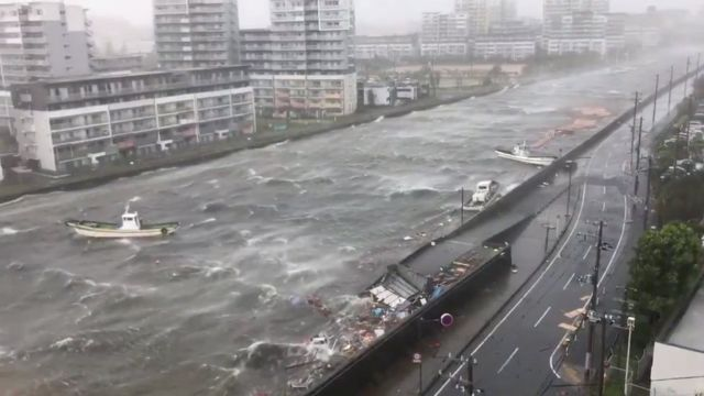 Boats float along with debris during Typhoon Jebi in Nishinomiya City