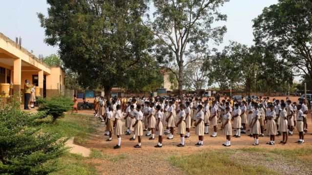 Students assemble on their school compound on the first day of the reopening of schools in Accra, Ghana, on January 18, 2021. - Ghana reopened schools after a 10-month closure to help control the spread of the COVID-19 coronavirus.