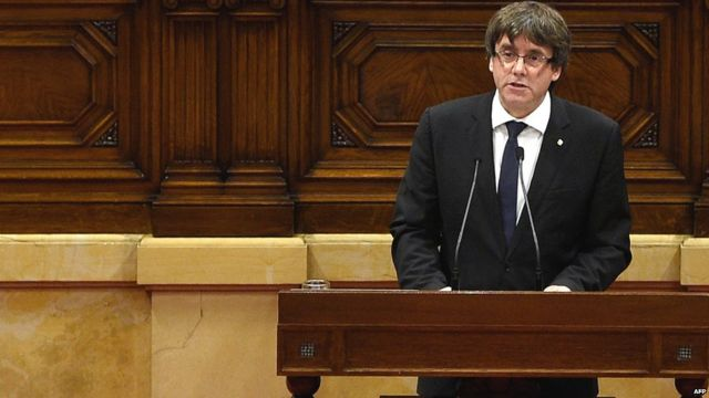 Carles Puigdemont gives a speech at the Catalan regional parliament in Barcelona on October 10, 2017.