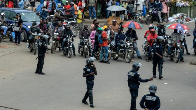 Police, okada men and people for street