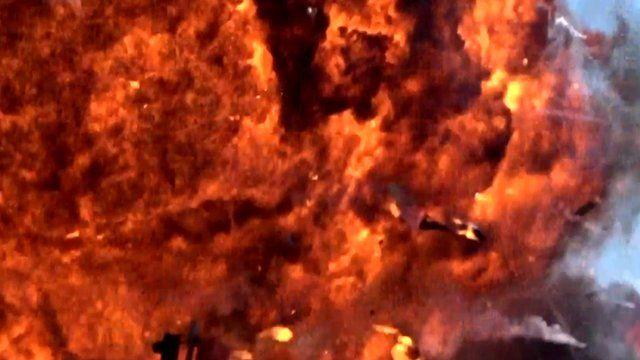 Explosion as a vintage jet plummets into traffic