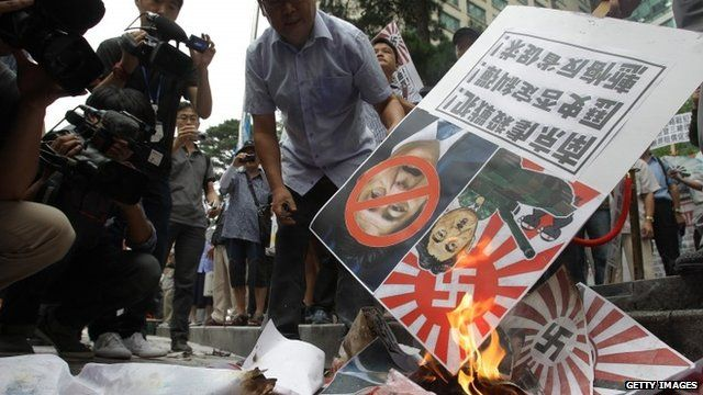 Placards depicting Japanese PM Shinzo Abe as Hitler