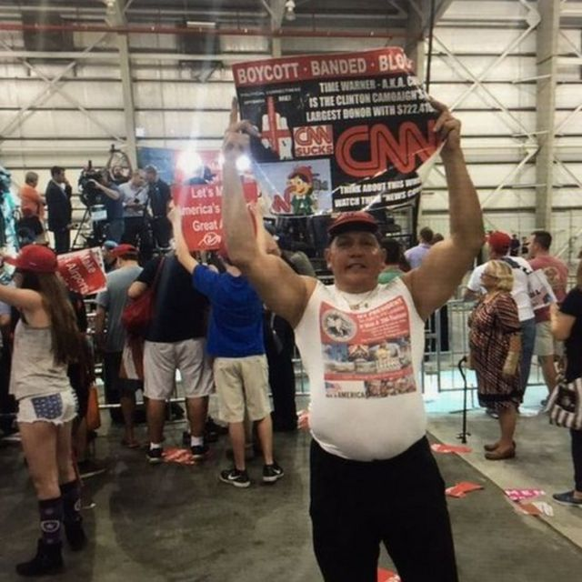 Twitter photo of Mr Sayoc holding an anti-CNN poster