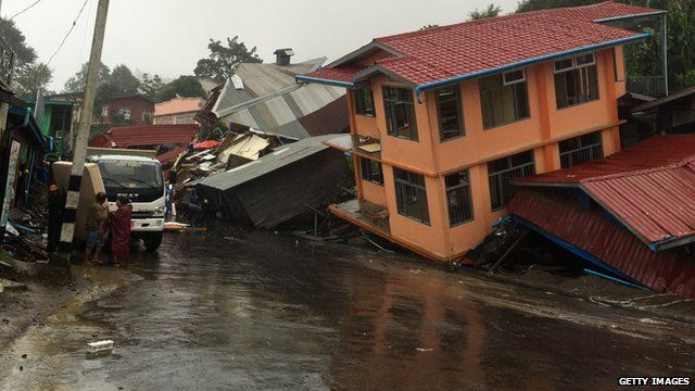 Apartments are destroyed following a landslide due to heavy rain in Harkhar, Chin State of Myanmar on July 30, 2015.